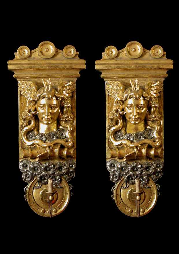 A pair of roman carved and giltwood mask appliques
