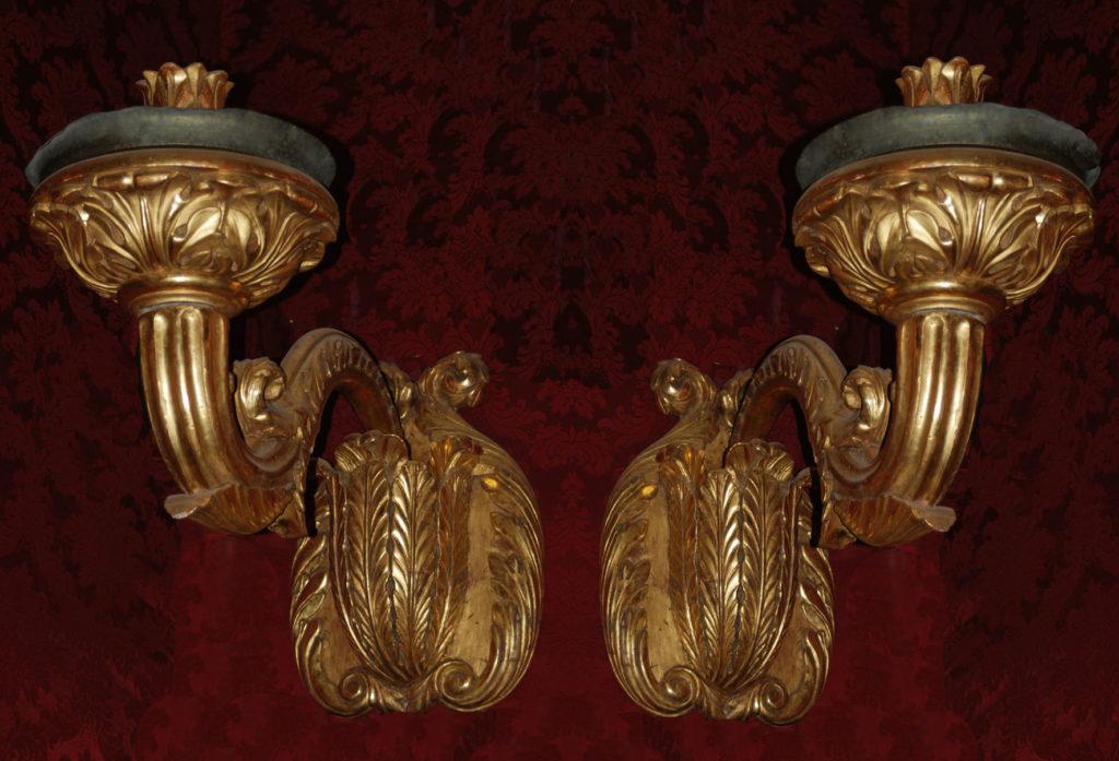 A pair af candlestick appliques