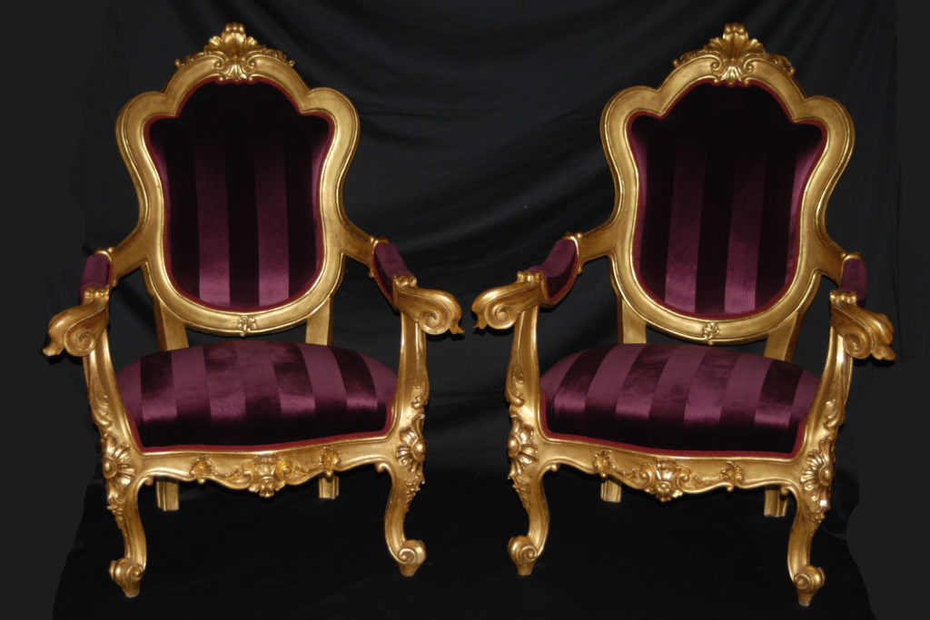 A pair of roman armchairs